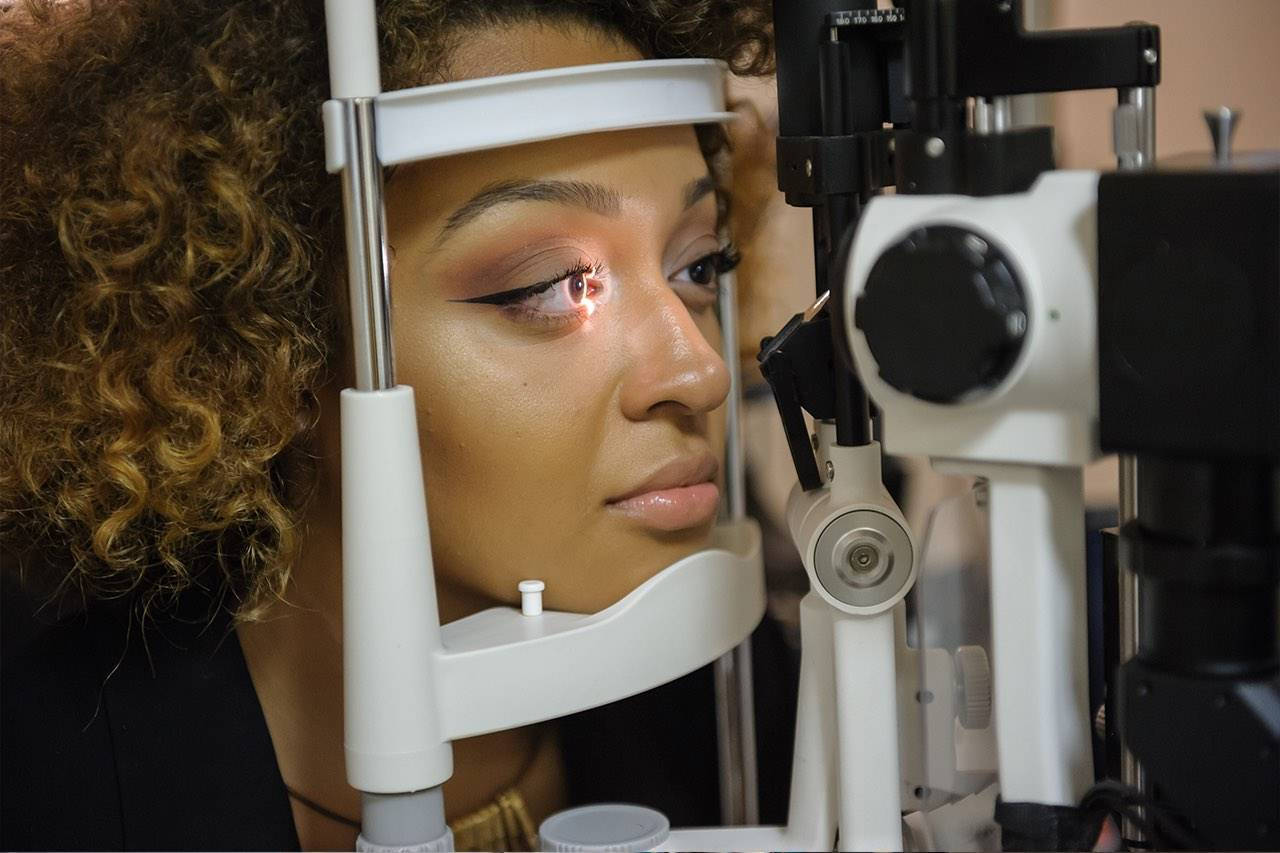 african american woman getting eye exam in tempe az